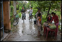 Canalside street with bicyclists and food stand, Thanh Toan. Hue, Vietnam (color)