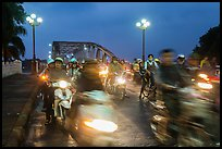 Night motorcyle traffic out of Trang Tien bridge. Hue, Vietnam ( color)