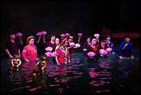 Water puppet artists standing in pool after performance, Thang Long Theatre. Hanoi, Vietnam (color)