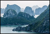 Monolithic karstic islands from above. Halong Bay, Vietnam ( color)