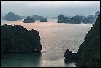 Elevated view of monolithic islands from above, evening. Halong Bay, Vietnam (color)