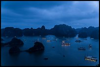 Tour boats lights and islands from above at night. Halong Bay, Vietnam ( color)