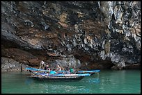 Fishermen anchor in cave for breakfast. Halong Bay, Vietnam ( color)