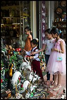 Children checkout ceramic store. Bat Trang, Vietnam ( color)