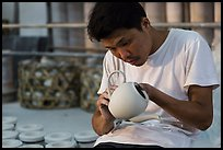 Man assembling ceramic tea pot in workshop. Bat Trang, Vietnam ( color)