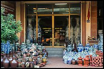 Ceramic store front with vases of all sizes. Bat Trang, Vietnam ( color)