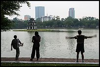 People exercising in front of Turtle Tower, Hoang Kiem Lake. Hanoi, Vietnam (color)