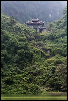 Temple perched on lush hill, Trang An. Ninh Binh,  Vietnam ( color)