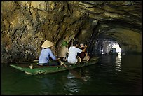 Boat rowed inside grotto passage, Trang An. Ninh Binh,  Vietnam ( color)