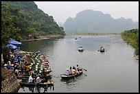 Groups leaving wharf on boats, Trang An. Ninh Binh,  Vietnam ( color)