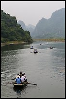Boats in karstic lanscape of steep cliffs, Trang An. Ninh Binh,  Vietnam ( color)