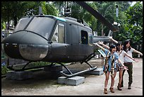 Young women posing with helicopter, War Remnants Museum, district 3. Ho Chi Minh City, Vietnam ( color)