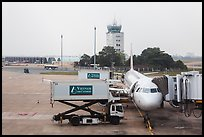 Airliner and control tower, Tan Son Nhat airport, Tan Binh district. Ho Chi Minh City, Vietnam (color)