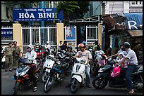 Parents waiting to pick up children in front of school. Ho Chi Minh City, Vietnam
