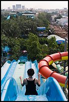 Woman on tall water slide, Dam Sen Water Park, district 11. Ho Chi Minh City, Vietnam ( color)