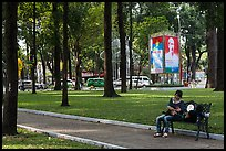 Relaxing on a public bench in April 30 Park. Ho Chi Minh City, Vietnam