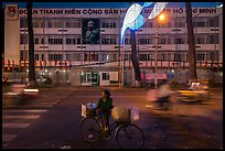 Vendor with bicycle at night. Ho Chi Minh City, Vietnam