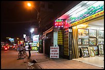 Stores selling pictures at night. Ho Chi Minh City, Vietnam