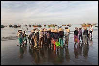 Women gather on beach to collect freshly caught fish. Mui Ne, Vietnam ( color)