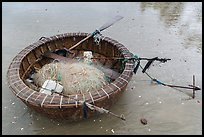 Round coracle boat with fishing gear. Mui Ne, Vietnam (color)