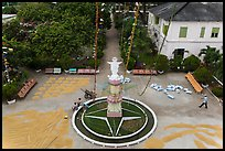 View of drying rice and statue from church tower. Tra Vinh, Vietnam ( color)