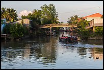 Barge and canal-side houses. Mekong Delta, Vietnam ( color)