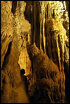 Tourist framed by cave formations, upper cave, Phong Nha Cave. Vietnam