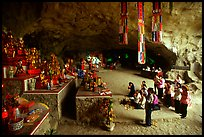Group praying at the altar at the entrance of Tan Thanh Cave. Lang Son, Northest Vietnam