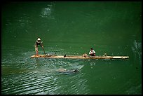 Crossing the Ky Cung  River on a narrow dugout boat. Northest Vietnam ( color)