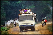 Passengers sitting on top of an overloaded bus. Northest Vietnam