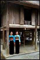 Two thai women standing in front of their stilt house, Ban Lac village. Northwest Vietnam