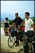 Western adventure travellers on mountain bikes, near Tam Duong. Northwest Vietnam