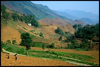 Two montagnards walking down a field, between Tuan Giao and Lai Chau. Northwest Vietnam (color)