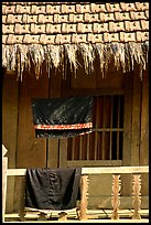 Detail of hut with montagnard dress being dried, between Tuan Giao and Lai Chau. Northwest Vietnam