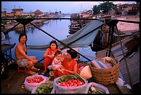 Family selling fruit on a bridge. Cholon, Ho Chi Minh City, Vietnam