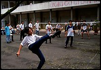 Students playing foot-only volley-ball in a school courtyard. Ho Chi Minh City, Vietnam (color)