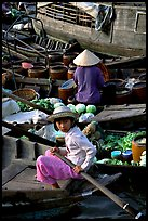 Child at Phung Hiep floating market. Can Tho, Vietnam