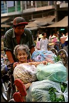Elderly woman back from the market with plenty of groceries makes good use of cyclo. Cholon, Ho Chi Minh City, Vietnam ( color)