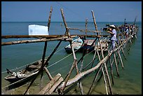 An ice block being loaded into a fishing boat. Vung Tau, Vietnam