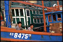 Fishermen on a commercial fishing boat. Ha Tien, Vietnam (color)