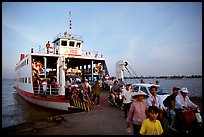 Disembarking from a ferry on one of the many arms of the Mekong. My Tho, Vietnam