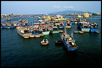 Colorfull fishing boats. Note the circular basket boats used to get to shore.  Nha Trang. Vietnam
