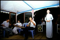 Traditional floating concert on the Perfume river. The city has remained Vietnam's artistic center. Hue, Vietnam