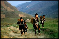 Hmong women returning to their village, which cannot be reached by the road. Sapa, Vietnam
