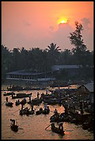 River activity at sunrise. Can Tho, Vietnam ( color)