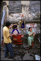 Hairdressing in the street. Ho Chi Minh City, Vietnam (color)
