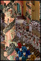 Priests and ornate columns inside the Great Caodai Temple. Tay Ninh, Vietnam ( color)
